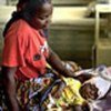 Mother with child ill with malaria