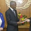 Panel chairman Panyarachun (R) presents report to Annan