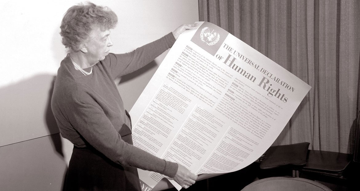 Eleanor Roosevelt holds an English version poster of the Universal Declaration Human Rights (November 1949).