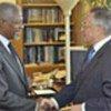 Annan (L) with IMO chief Efthimios Mitropoulos