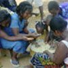 Togolese refugees prepare food with  Ghanaian hosts
