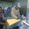 Refugees process maize at Mayukwayukwa camp