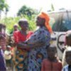 Josephine (right) hugs her mother during visit home