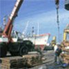Goods being loaded and unloaded at port