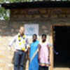 Edward Benson & residents of a new UNHCR-funded shelter