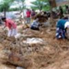 People root through debris where homes once stood