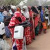 Somali refugees receiving supplies from UNHCR