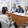 A. Jolie sits in as UNHCR staff interview refugees