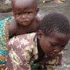Child picking up scraps of food