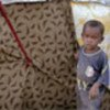 Somali boy stands outside shelter in town of Afgooye