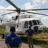 Helicopter is flying aid to marooned flood survivors
