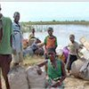 Evacuees rescued by boats along the Zambezi River Valley