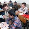 Afghan refugee children in Iran speak with  Erika Feller