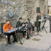 Roma musicians performing outside the national gallery, Cifte Amam, in Skopje