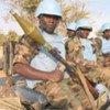 Forces de la MINUAD protégeant un convoi de matériels à El Fasher, dans la région soudanaise du Darfour