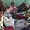 Cyclone-affected families take refuge at Leikkukone Pagoda in Pyapon township, Myanmar