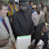 Members of Security Council delegation with Vice President Salva Kiir (C) speaking to reporters