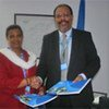 UNHCR's Guenet Guebre-Christos and UNICEF's Martin Mogwanja after signing the MoU on vaccine procurement