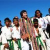 Jackie Chan with members of a martial arts group in Ainaro (Timor-Leste)