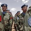 Chinese Engineers working for the UN-African Union Mission in Darfur (UNAMID) stand to attention upon arrival at their duty station in Nyala.