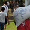 Some of the displaced queue up for food assistance in Mindanao
