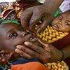 A boy receives vitamin A droplets