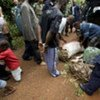 With UN help, Liberian police stop and search a car suspected of carrying drugs