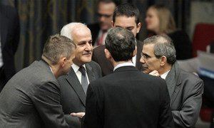 Palestine Permanent Observer Riyad H. Mansour (second from left) participates in Security Council meeting