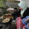 A Palestinian child eats home-made bread in the southern Gaza town of Rafah. Very few bakeries in the Strip still have flour to make bread.