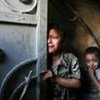 Palestinian children cower in fear during Israeli military offensive in Gaza