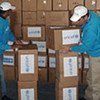 In a UNICEF warehouse in Zarka, Jordan, workers review boxes of supplies for shipment to the Gaza Strip