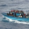 A boat carrying asylum seekers and migrants in the Mediterranean Sea.