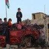 Des enfants jouent au milieu de ruines à Gaza.