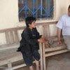 John Solecki avec un réfugié afghan à Quetta.