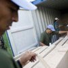 UN peacekeepers in Haiti load container with electoral material for the 19 April election