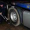 An inspector checks vehicle transporting highly enriched uranium across the border from the Czech Republic