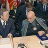 Secretary-General Ban Ki-moon confers with President Hamid Karzai during conference