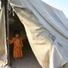 A young Afghan stands in the entrance of a UNHCR-supplied tent. Facebook users can help buy such tents for refugees