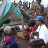A UNHCR staff member talks to displaced people in northern Sri Lanka