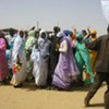 Sudanese refugee women performing a traditional Darfurian dance