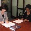 Mrs. Ines Alberdi (left) Mrs. Anna Tibaijuka (right) sign Memorandum of Understanding