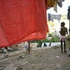 Children amid laundry hanging to dry in  Haiti where extreme poverty fuels the child domestic worker market