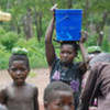 Refugees who fled rebel LRA attacks fetch water at the Makpandu refugee camp in southern Sudan