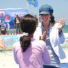UN aid worker Johanne van Dijk chats with a participant at the Gaza Summer Games