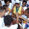Olympic gold medalist and Brazilian beach volleyball star, Jacqueline Silva, with adoring children