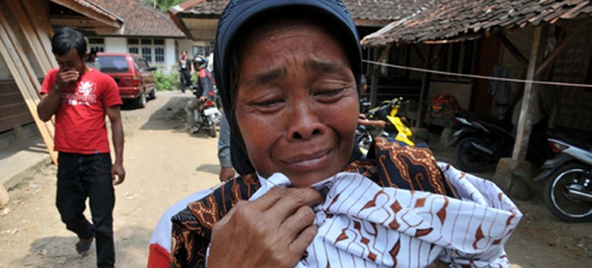 A survivor outside her home in West Java Province, Indonesia, following the powerful quake on on 2 September 2009.