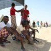 Passengers recover on the Yemen coast after making the perilous Gulf of Aden crossing