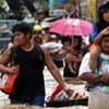 People wading through flood water from Typhoon Ondoy in the Phillipines capital Manila