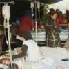 Victims of the earthquake that struck the Indonesian island of Sumatra being treated at a make-shift hospital