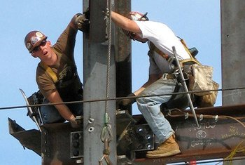 Ironworkers at work erecting the steel frame of a new building.
